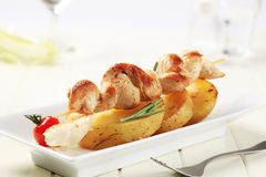 Chicken kebab and roasted potatoes Royalty Free Stock Images