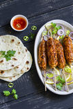 Chicken kebab, salad with tomatoes, onions and olives, homemade tortilla is a healthy and delicious meal Stock Photography