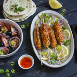 Chicken kebab, salad with tomatoes, onions and olives, homemade tortilla is a healthy and delicious meal Stock Photos