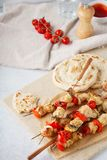 Chicken kebab on skewers with mushrooms, bell peppers and pitas royalty free stock image