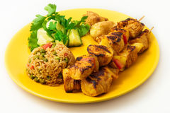 The chicken kebab on skewers with vegetables Royalty Free Stock Image