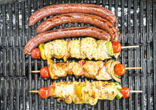 Chicken kebabs and barbequed merguez Royalty Free Stock Photography