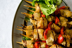 Chicken kebabs with bell pepper and salad. Roast Chicken filet kebab on bamboo sticks Stock Photos