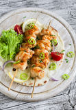 Chicken kebabs and fresh vegetable salad on a homemade tortilla Royalty Free Stock Images