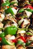 Chicken kebabs grilling royalty free stock image