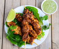 Chicken kebabs. Juicy chicken grilled kebabs served with mint chutney and lime Royalty Free Stock Images