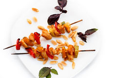 Chicken kebabs with pepper and zucchini. On white Stock Photo