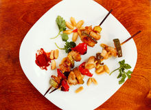 Chicken kebabs with pepper and zucchini. On wooden table Stock Image