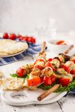 Chicken kebabs on skewers with mushrooms, bell peppers, onions stock images