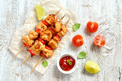 Chicken kebabs on wooden skewers Stock Photography