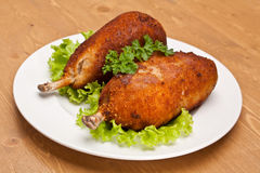 Chicken Kiev on a bone. On wooden table Stock Photography