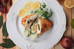 Chicken Kiev. Breaded chicken breast stuffed with herbs and butter Stock Images