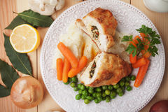 Chicken Kiev. Breaded chicken breast stuffed with herbs and butter Royalty Free Stock Photos