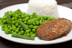 Chicken kiev or cordon bleu dinner Royalty Free Stock Image
