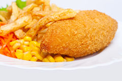 Chicken Kiev with corn and french fries stock image