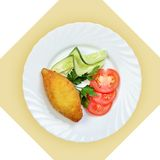 Chicken Kiev cutlet with vegetables. Royalty Free Stock Photography