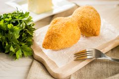 Chicken Kiev cutlets with parsley leaves and butter Stock Image