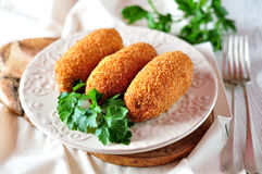 Chicken Kiev cutlets with parsley leaves. Ukrainian tradition food. Royalty Free Stock Photo