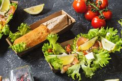 Chicken Kiev cutlets and Salad with smoked salmon in takeaway Box. Ukrainian tradition food royalty free stock image