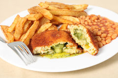 Chicken kiev fries and fork Stock Images