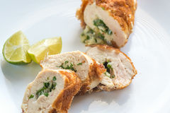 Chicken Kiev. Portion of chicken Kiev on the plate isolated stock images