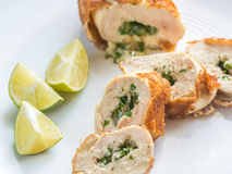 Chicken Kiev. Portion of chicken Kiev on the plate isolated Royalty Free Stock Photography
