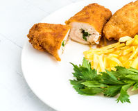 Chicken Kiev with roasted potatoes 10. Chicken Kiev with roasted potatoes on white plate Royalty Free Stock Photography