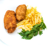 Chicken Kiev with roasted potatoes 2. Chicken Kiev with roasted potatoes on white plate Royalty Free Stock Images