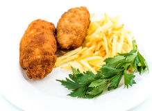 Chicken Kiev with roasted potatoes 4. Chicken Kiev with roasted potatoes on white plate Royalty Free Stock Image