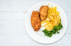 Chicken Kiev with roasted potatoes 5. Chicken Kiev with roasted potatoes on white plate Stock Photography