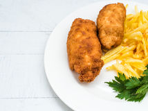 Chicken Kiev with roasted potatoes 6. Chicken Kiev with roasted potatoes on white plate Royalty Free Stock Images