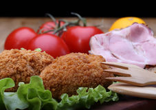 Chicken Kiev and sandwich Stock Photo