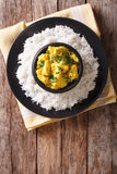 Chicken Korma of coconut and cream sauce served in a rice. Verti Stock Photography
