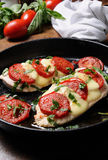 Chicken a la caprese. Langet from chicken breast with tomato and mozzarella. A-la caprese Royalty Free Stock Images