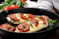 Chicken a la caprese. Langet from chicken breast with tomato and mozzarella. A-la caprese Stock Photo