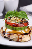 Chicken a la carte dishes. Chicken breast with slices of mozzarella, avocado, tomato and basil Stock Image