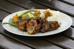 Chicken and Lamb Barbeque. Dish on a plate with mix vegetables and marsh potato Royalty Free Stock Photography