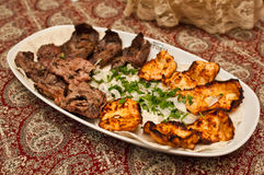 Chicken and lamb kebab. Served with diced onions Stock Image