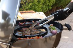Kebabs cooking on a barbecue Royalty Free Stock Image