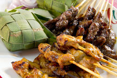 Chicken and Lamb Satay Skewers with Ketupat Rice. Wrapped in Coconut Leaf Stock Photo