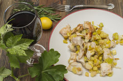 Chicken with leeks. Sauteed , a glass of wine, vine leaf Stock Images