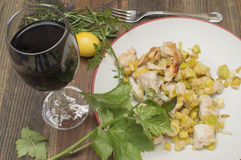 Chicken with leeks. Sauteed , a glass of wine, vine leaf Stock Photos