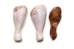 Chicken leg. Raw and Cooked chicken leg Stock Photography