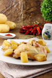 Chicken leg baked with potatoes Stock Photography