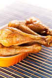 Chicken leg on bamboo napkin Stock Photo