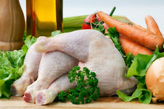 Chicken Leg on board with vegetables Stock Photo