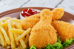 Chicken leg breaded Stock Images