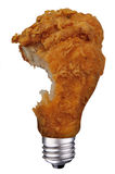 Chicken leg bulb with bite. Incandescent lightbulb with Chicken leg bulb with bite taken inside isolated over white with a clipping path Stock Photos
