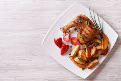 Chicken leg and chips on a plate. top view horizontal Royalty Free Stock Photos