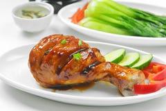 Chicken leg closeup Stock Images